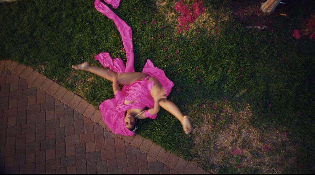 Chlöe Bailey wearing sheer pink ensemble with legs spread open
